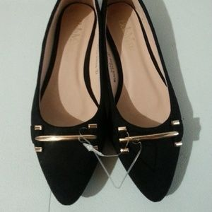 Bella Marie Black flats with gold buckle. Size 6.